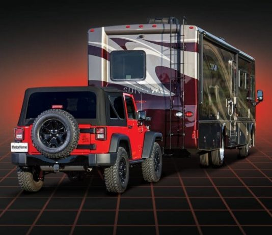 A Jeep wrangler hitched behind a class A motorhome